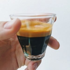 espresso coffee shot pulled with fresh beans